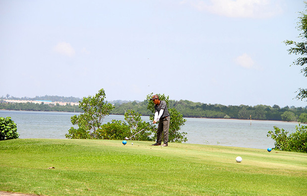 golfer at tering bay golf club in batam island indonesia