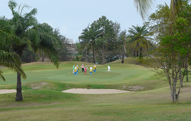 caddies on green crystal bay golf club, pattaya, thailand